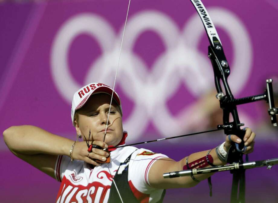 In this Aug. 2, 2012, file photo, Russia's Ksenia Perova shoots during the individual archery competition at the 2012 Summer Olympics in London. The archery federation said Monday, July 25, 2016, it had approved the entry of three Russian archers after determining they have no links to doping. They were listed as Tuiana Dashidorzhieva, Ksenia Perova and Inna Stepanova. Photo: AP Photo/Marcio Jose Sanchez, File    / Copyright 2016 The Associated Press. All rights reserved. This material may not be published, broadcast, rewritten or redistribu
