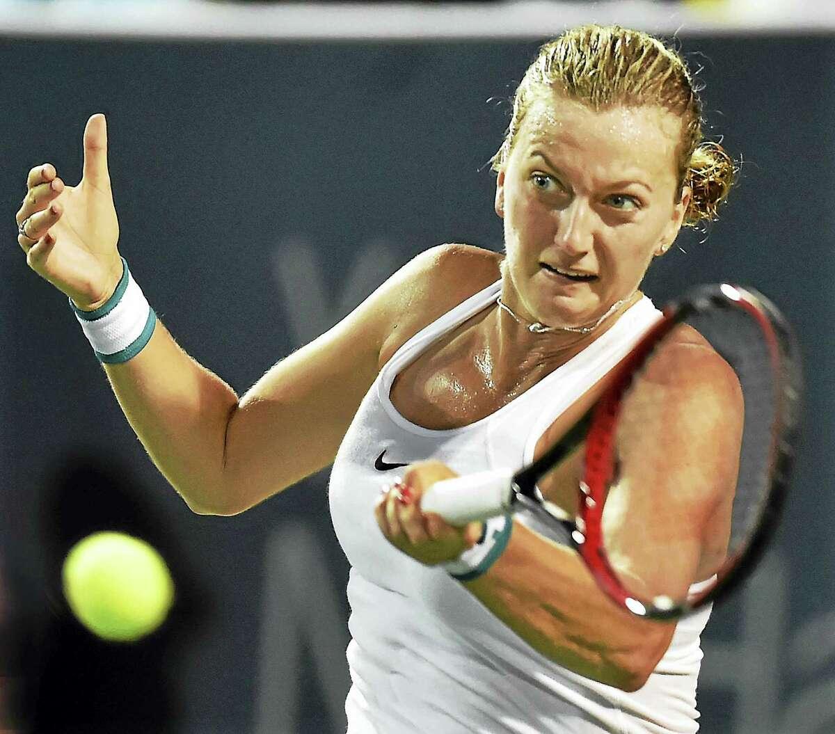 Petra Kvitova returns a shot against Agnieszka Radwanska.