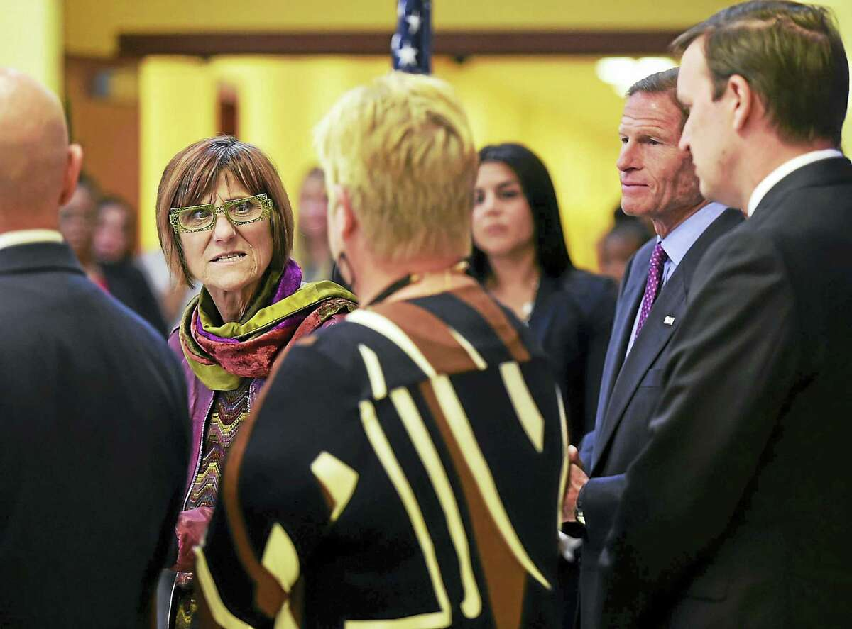 U.S. Rep. Rosa DeLauro left, with U.S. Sens. Richard Blumenthal, second from right, and Chris Murphy, far right, makes remarks to Principal Pam Franco of Robert Clemente Leadership Academy, third from left, during a press conference Thursday at the Robert Clemente Leadership Academy in New Haven announcing the award of an $11.7 million competitive federal grant to enhance and support magnet schools in New Haven.