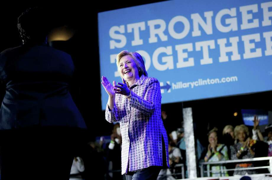 """Democratic presidential candidate Hillary Clinton arrives to speak to volunteers at a Democratic party organizing event in Charlotte, N.C., Monday. In her 2008 presidential run, Clinton said abortion should be """"safe, legal and rare, and by rare, I mean rare."""" The 2016 party platform makes no mention of """"rare,"""" and Clinton herself seems to have dropped the word from her political lexicon. Photo: AP / Copyright 2016 The Associated Press. All rights reserved. This material may not be published, broadcast, rewritten or redistribu"""