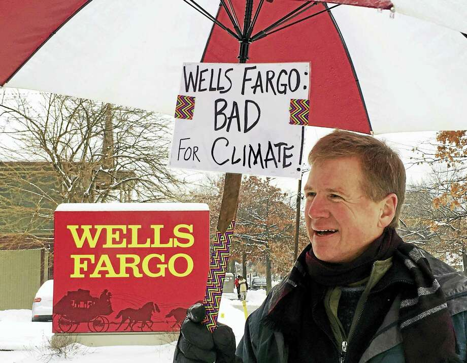 In this file photo, Chris Schweitzer of New Haven Climate Movement was among protesters in 2017 who advocated for Wells Fargo Bank to stop financing the Dakota Access Pipeline. Photo: Sam Norton — New Haven Register