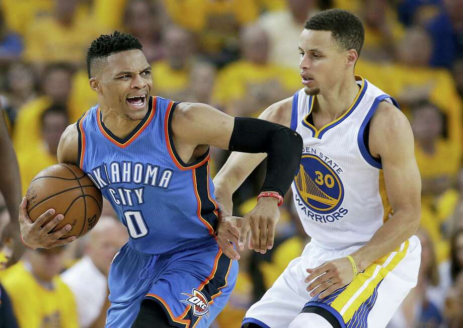 In this May 18, 2016 photo, Oklahoma City Thunder guard Russell Westbrook (0) reacts as he is guarded by Golden State Warriors guard Stephen Curry (30) during the second half of Game 2 of the NBA basketball Western Conference finals in Oakland, Calif. Photo: AP Photo/Marcio Jose Sanchez, File   / Copyright 2016 The Associated Press. All rights reserved.
