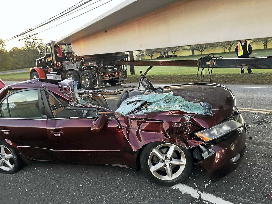Part of Route 139 in Branford was shut down for about an hour Wednesday, Oct. 26, 2016, after a car and tractor-trailer collided. The road reopened about 7:40 a.m. Photo: Courtesy Of Branford Police Department