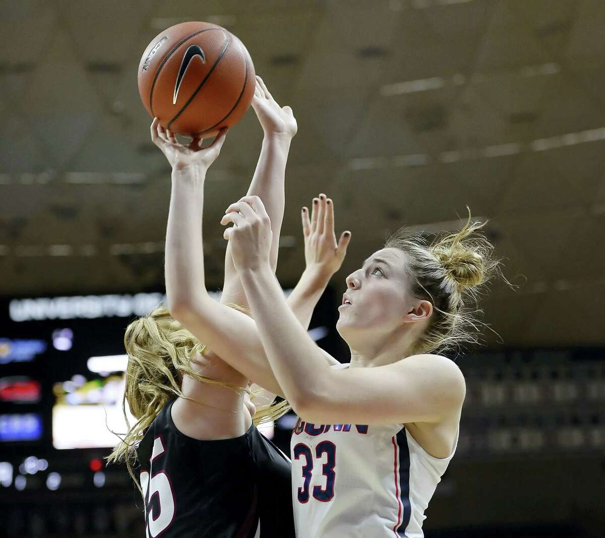 UConn's Katie Lou Samuelson, right, shoots as Indiana University of Pennsylvania's Maura D'Anna defends in the second half of UConn's 111-39 exhibition win at Gampel Pavilion.