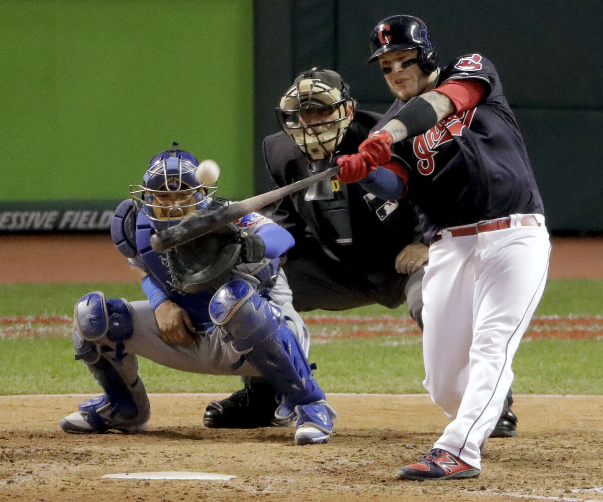Cleveland's Roberto Perez hits a three-run home run against the Chicago Cubs during the eighth inning of Game 1 of the World Series Tuesday. The Indians took the opener 6-0.