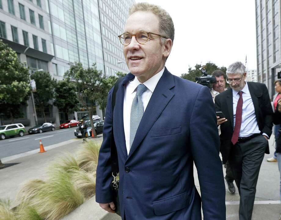 In this April 21, 2016 photo, Robert Giuffra, an attorney for Volkswagen, leaves the Phillip Burton Federal Building after a court hearing, in San Francisco. A $15 billion settlement over Volkswagen's diesel emissions cheating scandal faces a critical test, as a federal judge in San Francisco decides whether to grant it preliminary approval on Tuesday, July 26. Photo: AP Photo/Jeff Chiu, File   / Copyright 2016 The Associated Press. All rights reserved. This material may not be published, broadcast, rewritten or redistribu