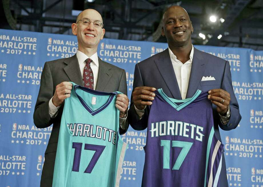NBA commissioner Adam Silver, left, and Charlotte Hornets owner Michael Jordan, right, pose for a photo during a news conference to announce Charlotte, N.C., as the site of the 2017 NBA All-Star basketball game on June 23, 2015. The NBA has since decided to move the game in response to legislation regulating how transgender indiviuals use bathroom facilities in North Carolina. Photo: AP Photo/Chuck Burton   / AP