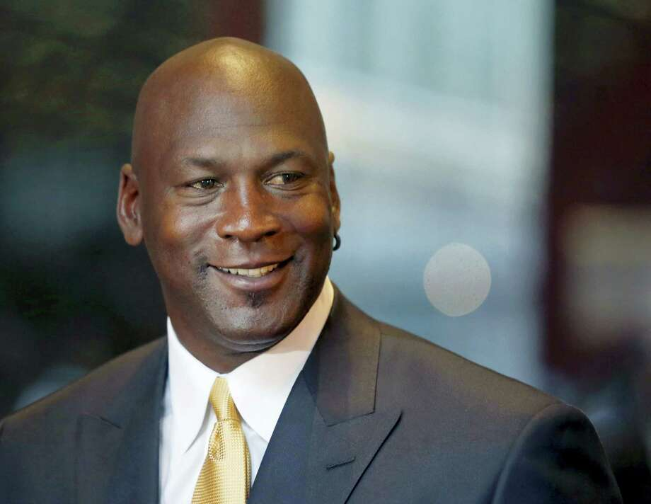 Former NBA star and current owner of the Charlotte Hornets Michael Jordan announced Monday that he's giving $1 million to the Institute for Community-Police Relations and $1 million to the NAACP Legal Defense Fund to help build trust between blacks and law enforcement following several disturbing clashes around the country. Photo: The Associated Press File PHOTO   / Copyright 2016 The Associated Press. All rights reserved. This material may not be published, broadcast, rewritten or redistribu
