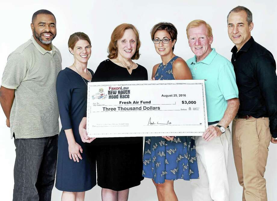 Left to right, Shahid Abdul-Karim, board member of the Register Fresh Air Fund, Mary-Kate Bzdyra, board member of the Register Fresh Air Fund, and Helen Bennett, president of the Register Fresh Air Fund, are presented with $3,000 by Christina Acampora, communications director  of Faxon Law Group and board member of the New Haven Road Race, John Courtmanche, president of the board of the New Haven Road Race, and John Bysiewicz, director of the New Haven Road Race, on 8/25/2016. Photo: Arnold Gold-New Haven Register