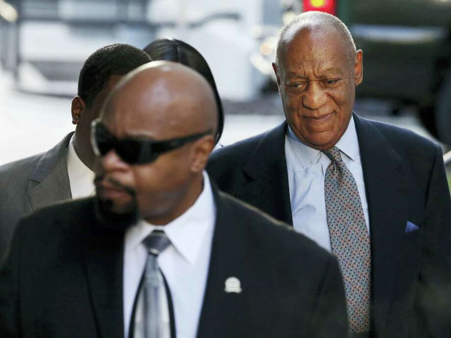 "Bill Cosby, right, arrives for a hearing in his sexual assault case at the Montgomery County Courthouse on Nov. 1, 2016 in Norristown, Pa. Prosecutors at the pretrial hearing on Tuesday will ask the judge to let the other accusers testify to show Cosby drugged and molested young women in a ""signature"" fashion. Photo: AP Photo/Mel Evans    / Copyright 2016 The Associated Press. All rights reserved."