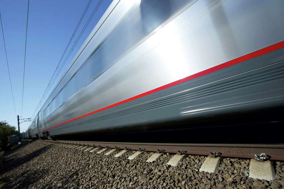 In this Oct. 18, 2016 photo, an Amtrak Acela train travels through Old Lyme, Conn. A plan to speed up Amtrak's high-speed rail corridor from Boston to Washington, D.C., is welcomed by business commuters but finding its strongest opposition in some shoreline towns in Connecticut. Photo: AP Photo/Michael Dwyer   / Copyright 2016 The Associated Press. All rights reserved.