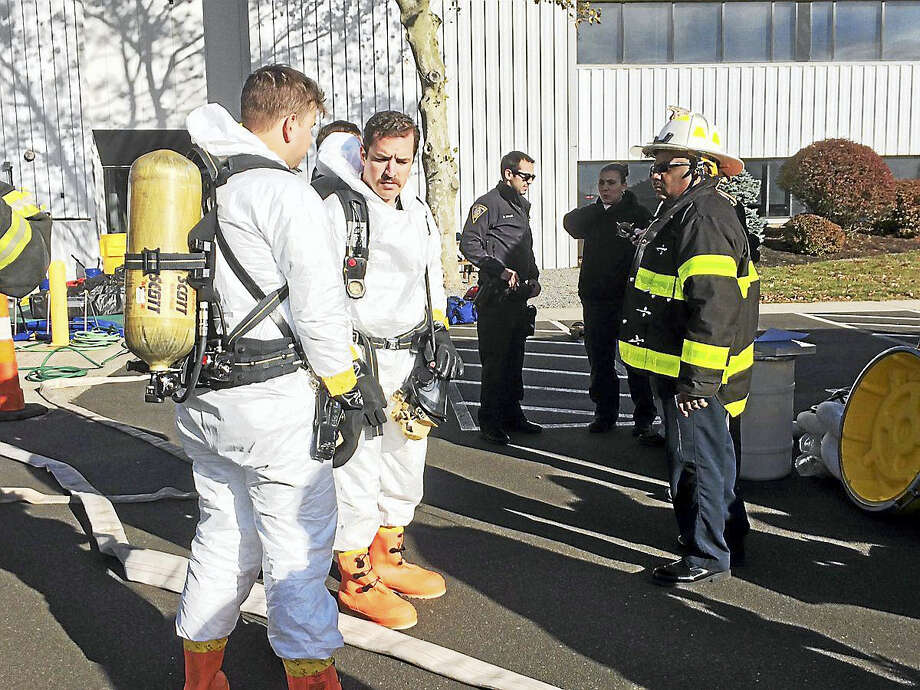 The New Haven Register building was evacuated about 2:20 p.m. Wednesday as fire, public safety and hazmat crews were called to 100 Gando Drive. Officials said a suspicious letter had prompted the investigation. The building was reopened at about 5:20 p.m. Photo: Wes Duplantier — New Haven Register
