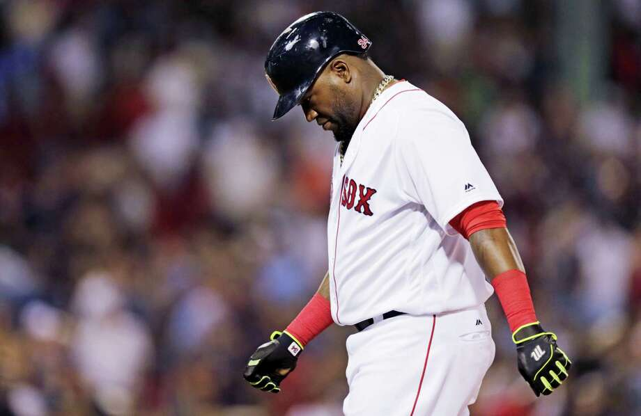 David Ortiz heads back to the dugout after grounding out to end the game on Monday. Photo: Charles Krupa — The Associated Press   / AP