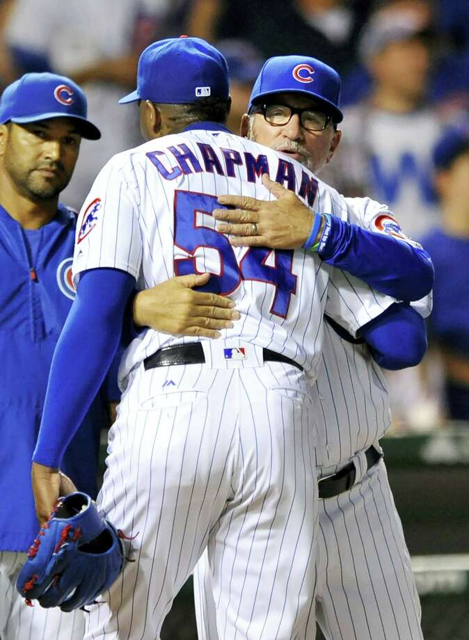 Aroldis Chapman (54) celebrates with manager Joe Maddon after a win last season. Photo: Paul Beaty — The Associated Press File   / FR36811 AP