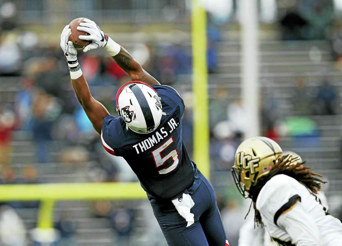 UConn wide receiver Noel Thomas (5) catches a pass against Central Florida.