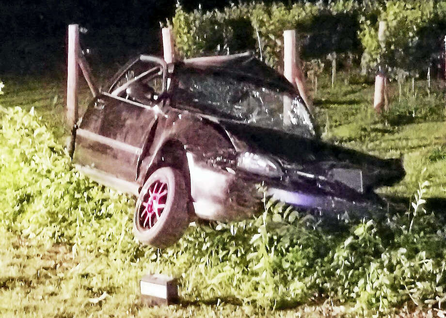 A West Haven man died early Sunday after he lost control of his car and crashed on Route 34 in Orange. Police said the car hit a large boulder and a fence off the road. Photo: Photo Courtesy Of Orange Police Department