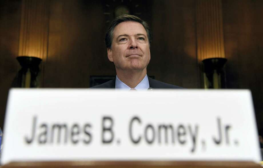 In this Dec. 9, 2015, file photo, FBI Director James Comey prepares to testify on Capitol Hill in Washington. Photo: The Associated Press   / Copyright 2016 The Associated Press. All rights reserved.
