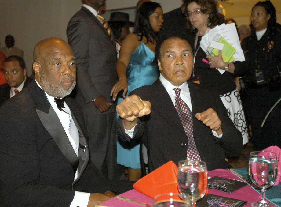 Photographer Howard Bingham, left, and longtime friend Muhammad Ali. Photo: The Associated Press File Photo   / Copyright 2016 The Associated Press. All rights reserved.