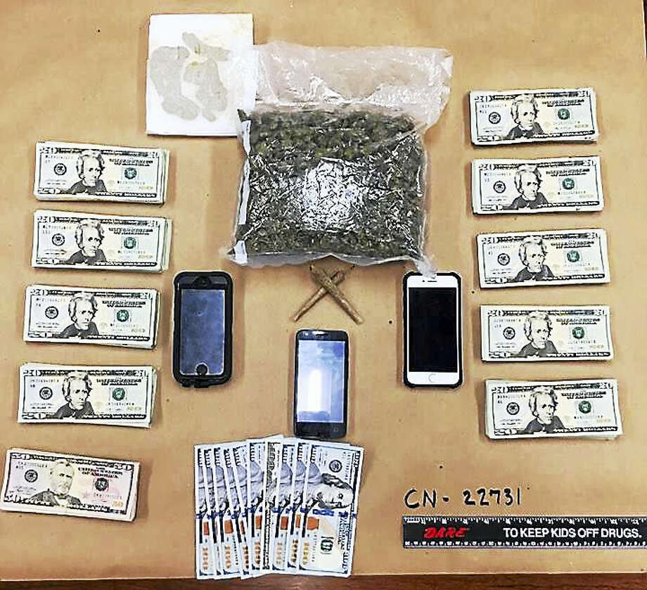 Two men are facing charges after North Haven police say they were found with 11 ounces of marijuana, hash oil and thousands of dollars in cash during a traffic stop. Photo: Courtesy Of North Haven Police Department