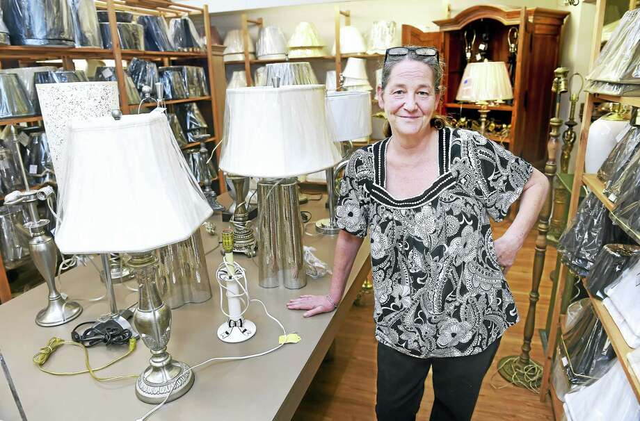 Jill Pendergast, owner of Lamp Shades Plus, is photographed at her remodeled store in Orange. Photo: Arnold Gold — New Haven Register