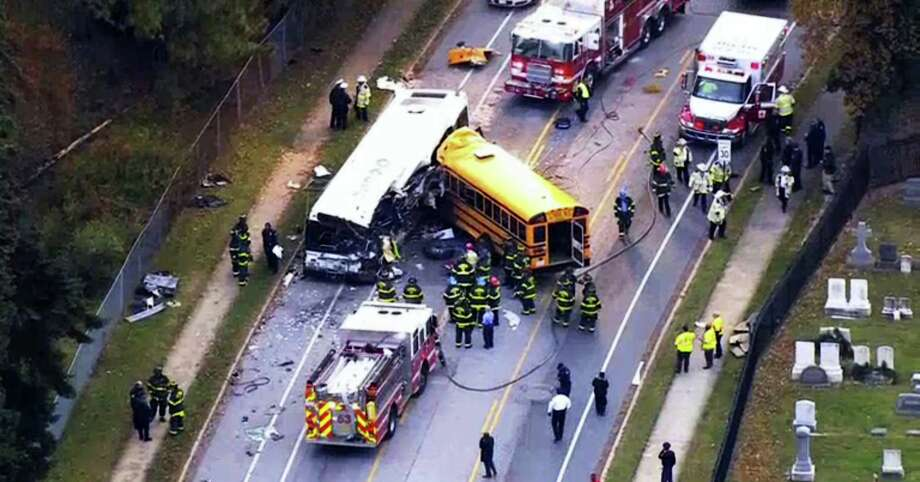 In this frame from video, emergency personnel work at the scene of a fatal school bus and a commuter bus crash in Baltimore, Tuesday, Nov. 1, 2016. Photo: WBAL-TV Via AP / WBAL-TV