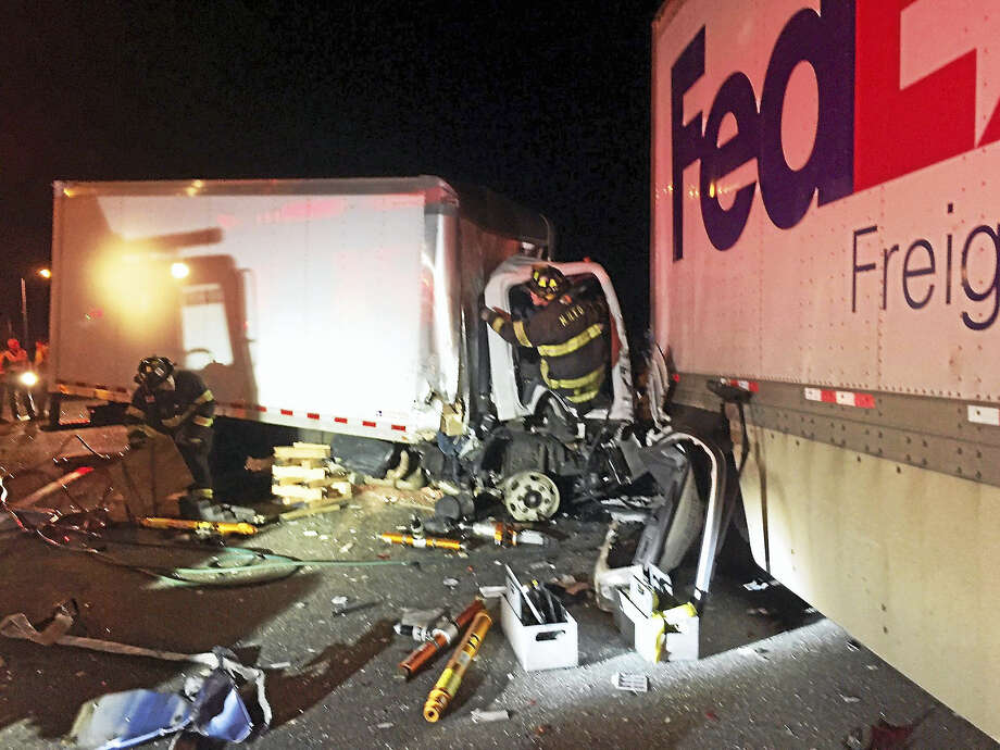 Three lanes of Interstate 91 south were shut down after a crash early Thursday that killed at least one person. Photo: New Haven Fire Department