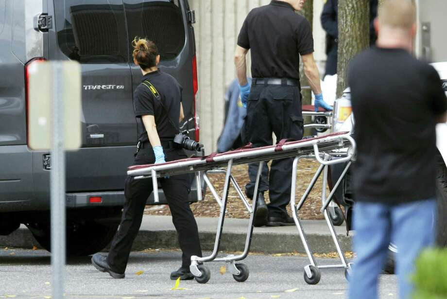 A worker carries a stretcher at the Cascade Mall Saturday, Sept. 24, 2016, in Burlington, Wash. Friday night, a man with a rifle opened fire in a Macy's Department Store at the mall, killing several people. Photo: AP Photo/Ted S. Warren   / Copyright 2016 The Associated Press. All rights reserved.