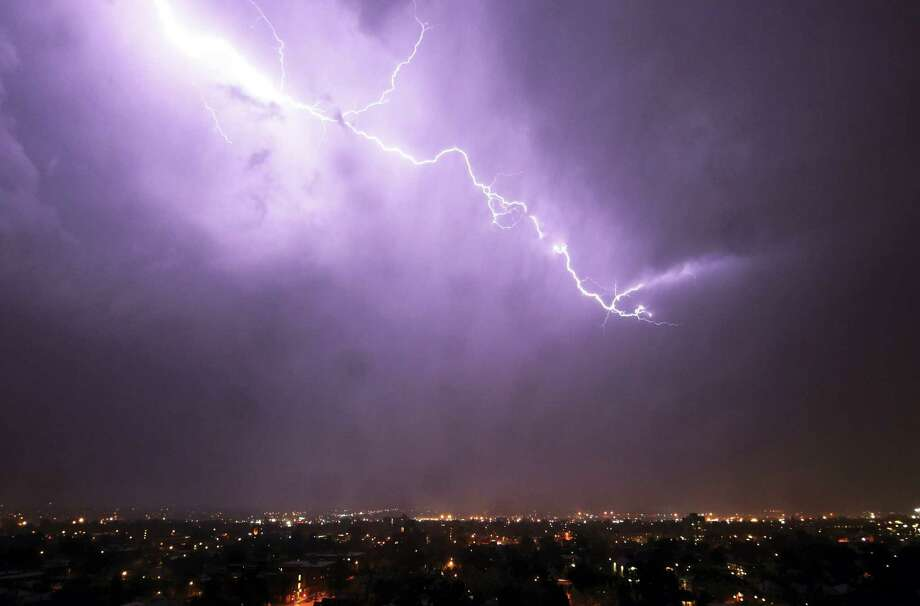 A bolt of lightning illuminates the sky over downtown Denver. The Greater New Haven area is under a severe thunderstorm warning. Photo: The Associated Press — FILE   / AP