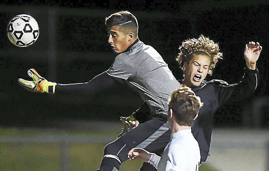 Hand senior Jackson Guay battles Guilford keeper Orlando Diaz in a 1-0 win Monday for the Tigers at the James W. Kavanaugh Athletic Complex at Guilford High School. Photo: Catherine Avalone — New Haven Register