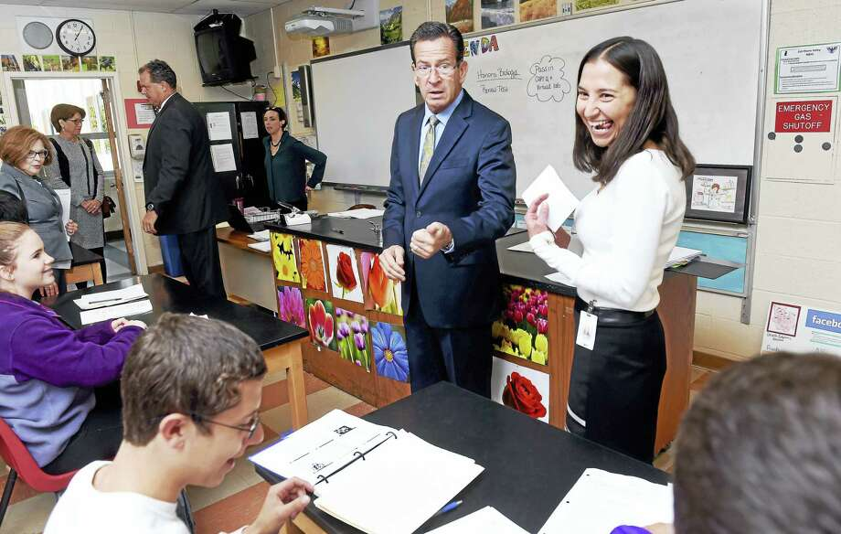 Gov. Dannel P. Malloy, center, meets with 2017 Connecticut Teacher of the Year Lauren Danner, right, in her tenth-grade biology class at North Branford High School Tuesday. Photo: Arnold Gold — New Haven Register