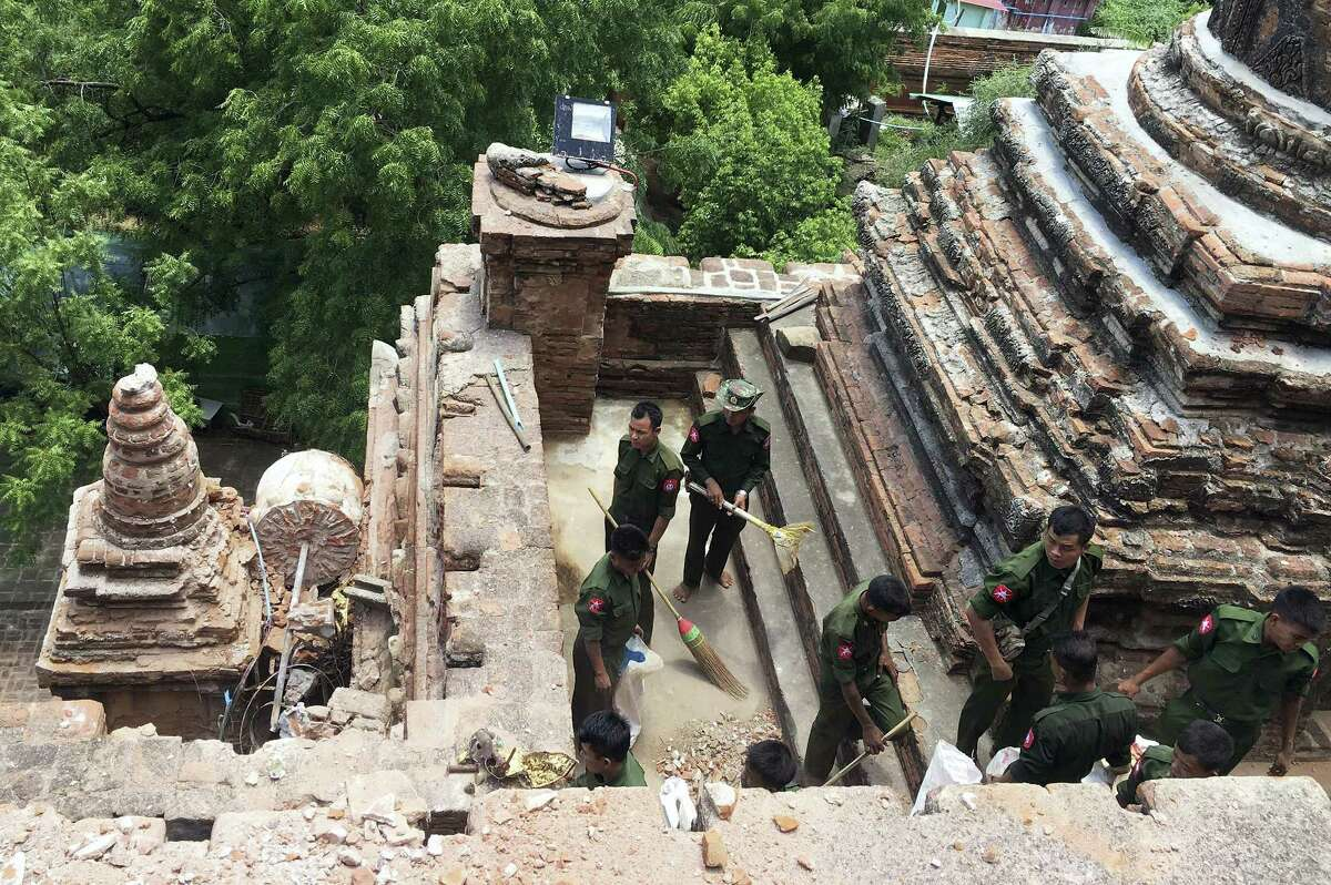 Military personnel clear debris at a temple that was damaged by a strong earthquake in Bagan, Myanmar on Aug. 25, 2016. Using brooms and their hands soldiers and residents of the ancient Myanmar city famous for it's historic Buddhist pagodas, began cleaning up the debris from a powerful earthquake that shook the region and damaged nearly 200 temples Wednesday.