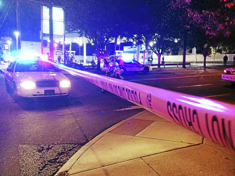 Police are investigating after a shooting Monday night left two men in the hospital. The shooting happened at the Hess gas station at the corner of Ferry and State streets. Photo: Brian Zahn — New Haven Register
