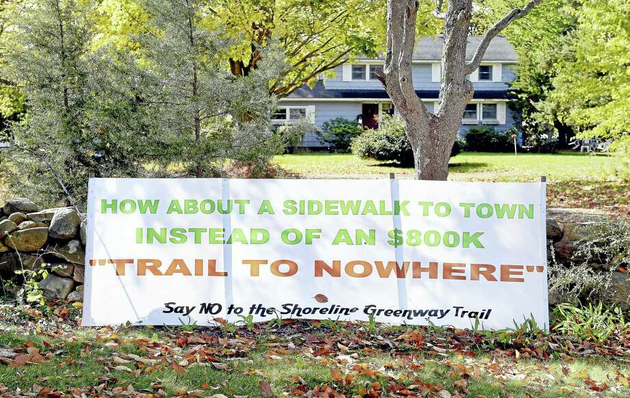 A banner protesting the Shoreline Greenway Trail is posted along Route 1 in Guilford where a proposed section of the trail would pass. Photo: Arnold Gold — New Haven Register