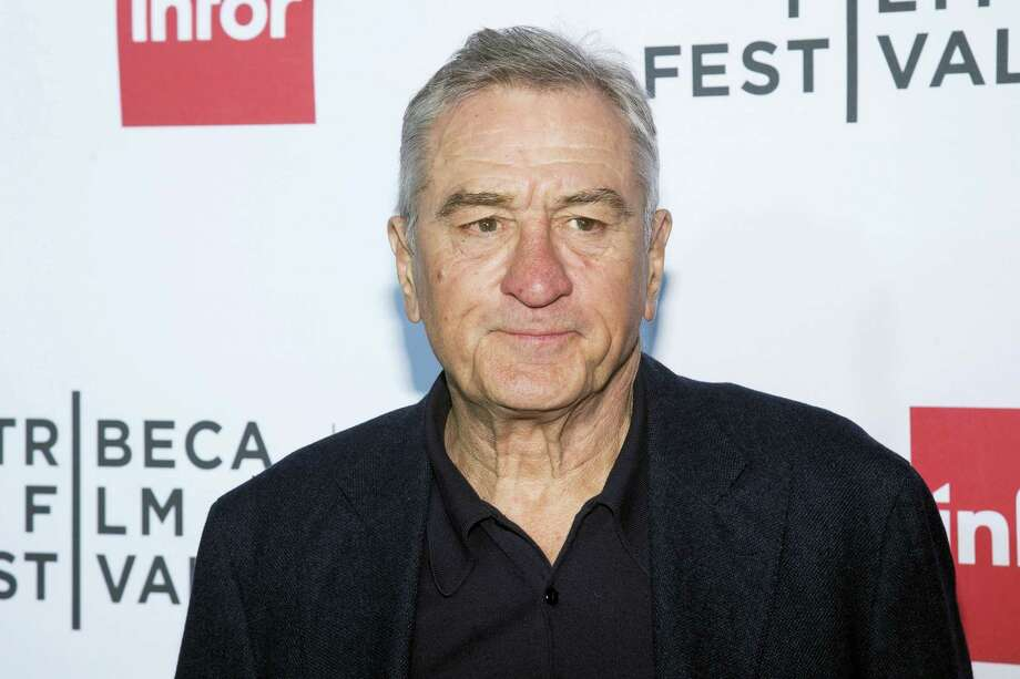"In this April 21, 2016 file photo, Robert De Niro attends a special 40th anniversary screening of ""Taxi Driver"" during the 2016 Tribeca Film Festival in New York. The 2016 election has provoked a visceral, intense response from many in the arts community, prompting songs, videos and uncommon ferocity against Trump, arguably once one of their own. De Niro called Trump ""a dog,"" ""a pig,"" ""an idiot"" and ""a mutt, who doesn't know what he's talking about."" Photo: Photo By Charles Sykes/Invision/AP, File    / Invision"