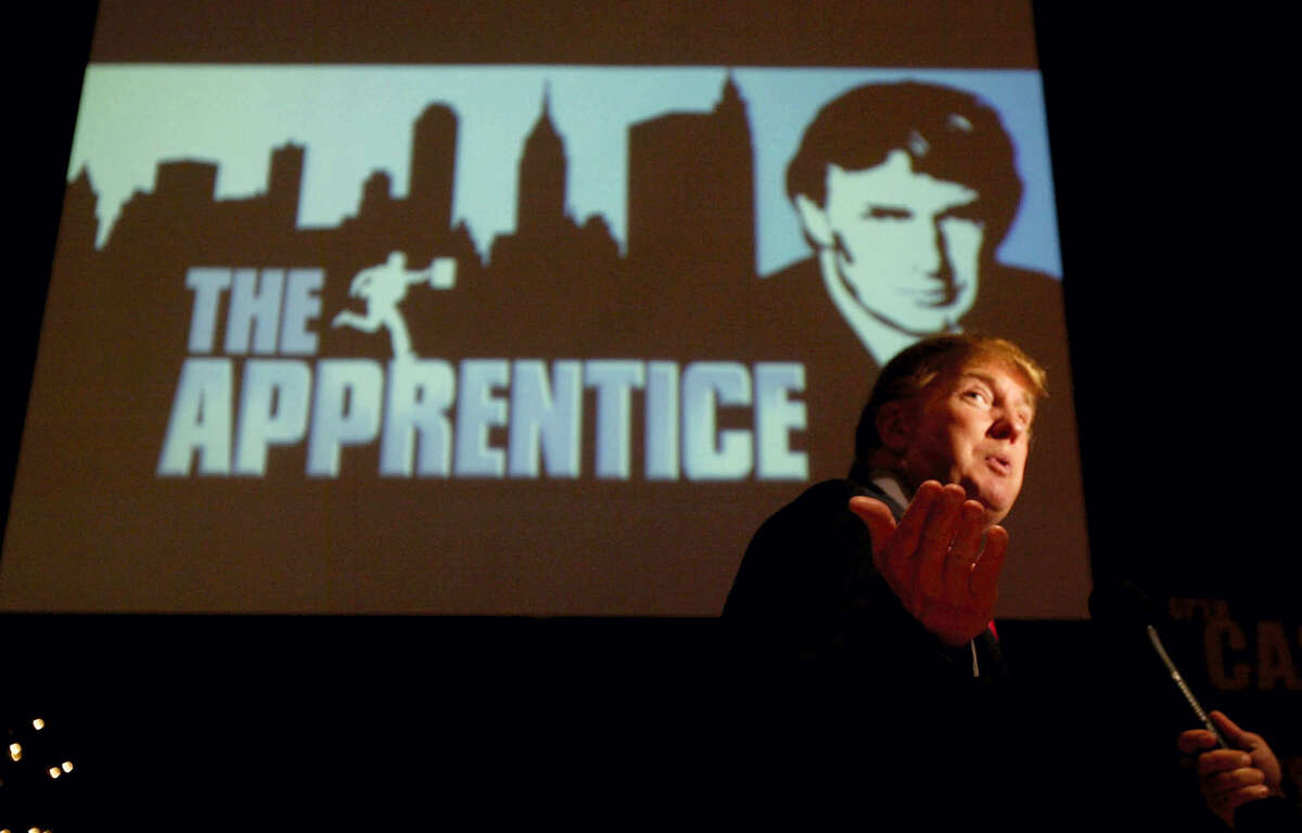 """In this July 9, 2004 photo, Donald Trump, seeking contestants for """"The Apprentice"""" television show, is interviewed at Universal Studios Hollywood in the Universal City section of Los Angeles."""