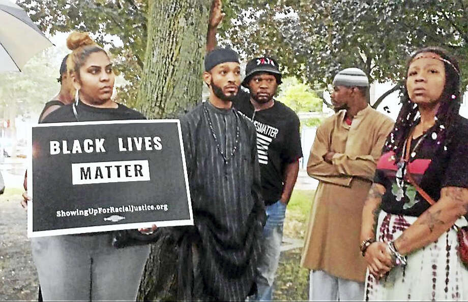 Demonstrators gather for Black Lives Matter rally Monday night in response to the death of Daryl Wayne Belton, 22, over the weekend in New Haven. Photo: Anna Bisaro — New Haven Register
