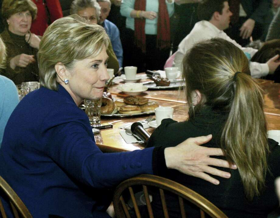 "In this Jan. 7, 2008 photo, Democratic presidential hopeful Sen. Hillary Clinton, D-N.Y., left, talks to Laura Styles of Exeter, N.H., after become emotional while answering a question from an undecided voter at a cafe in Portsmouth, N.H. Of this ""coffee shop moment,"" biographer Gail Sheehy says, ""She allowed herself to show a little vulnerability — in spite of herself — and wow, women all over the place related to her."" Photo: AP Photo/Elise Amendola, File   / AP2008"