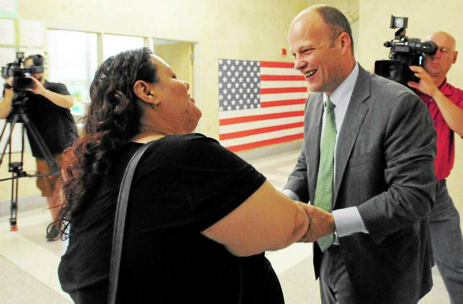 Peter Hvizdak — Register  Garth Harries, newly appointed City of New Haven Superintendent of Schools, right,  is congratulated by East Rock School PTO President and  Citywide Parent Leadership Team member Daisy Y. Gonzales Thursday July 25, 2013 at the Fair Haven School in New Haven. Photo: New Haven Register / ©Peter Hvizdak /  New Haven Register