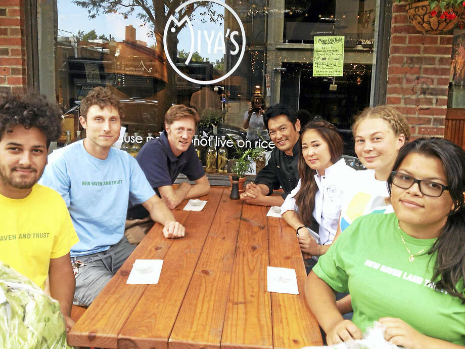 Visitors to Miya's Sushi restaurant after students sold it bok choy they grew. From left, Xavier Hernandez, Bradley Fleming, Justin Elicker, Bun Lai, Miya Lai, Sarah Gilbert and Sadilka Lopez. Photo: Mary O'leary - New Haven Register