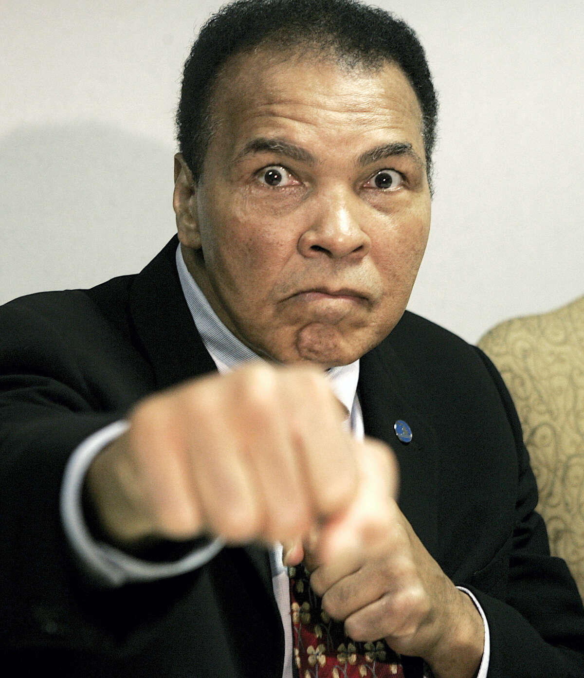 This is an Oct. 4, 2006 photo showing Muhammad Ali posed in Detroit. The Muhammad Ali Center in Kentucky says it's planning a four-day celebration early next year to coincide with what would have been the boxing great's 75th birthday. The community activities at the downtown center in Ali's hometown of Louisville will start Jan. 14 and continue through Ali's birthday on Jan. 17.