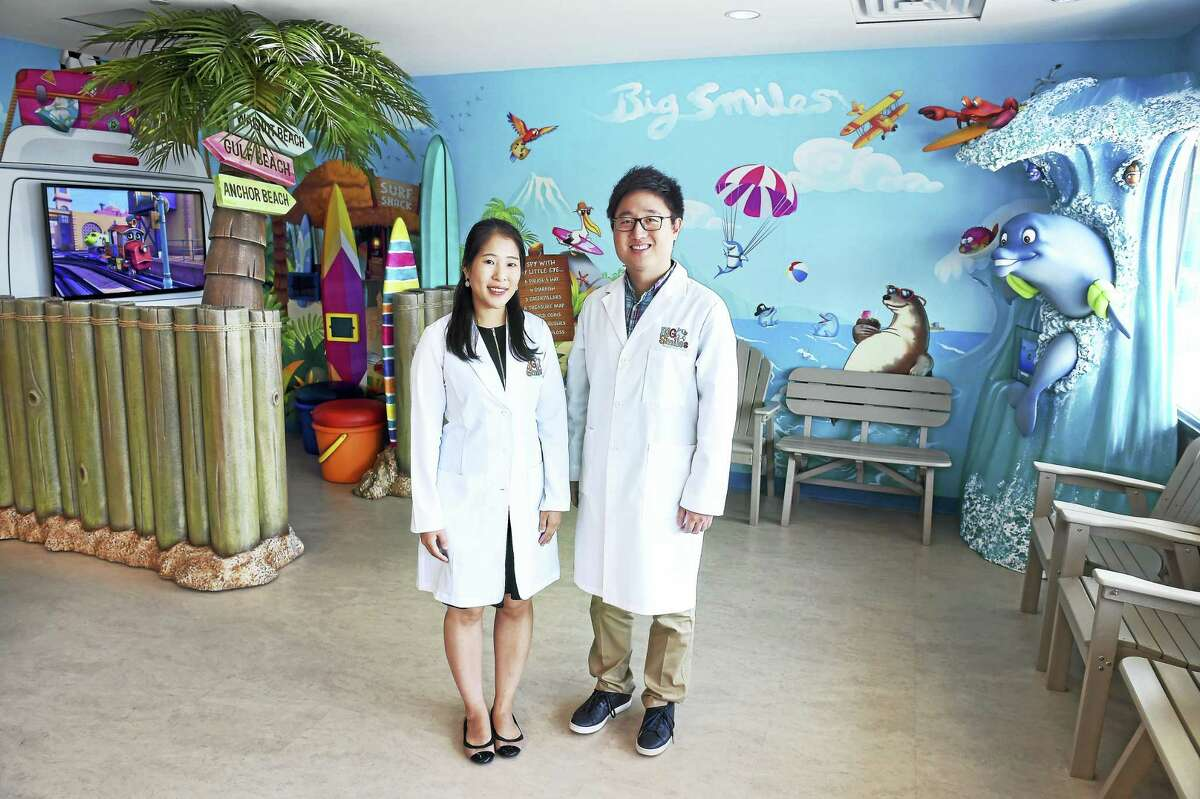 Arnold Gold - New Haven Register Dr. Eunice Lee (left) and Dr. Wesley Choi are photographed in the lobby of Big Smiles Pediatric Dentistry in Milford on 9/20/2016.