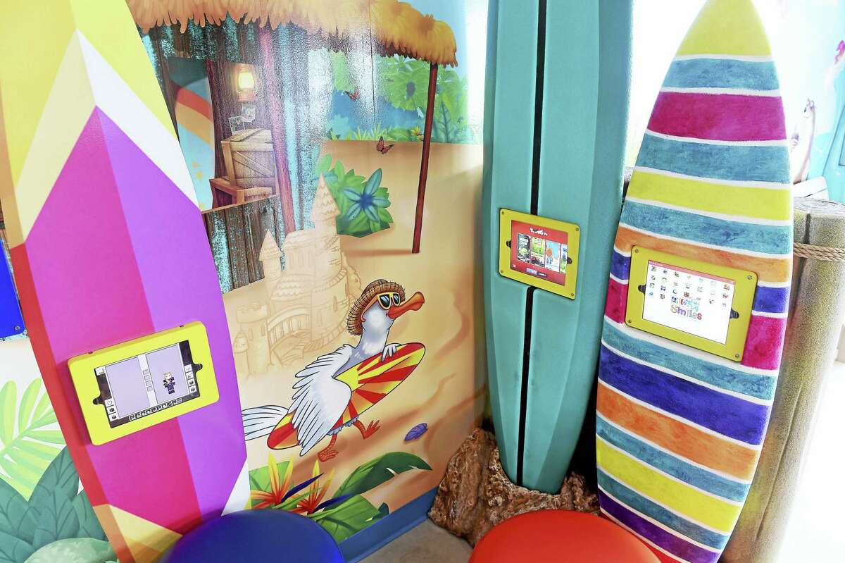 (Arnold Gold-New Haven Register) IPods mounted into surfboards are part of the decor in the lobby of Big Smiles Pediatric Dentistry in Milford on 9/20/2016.