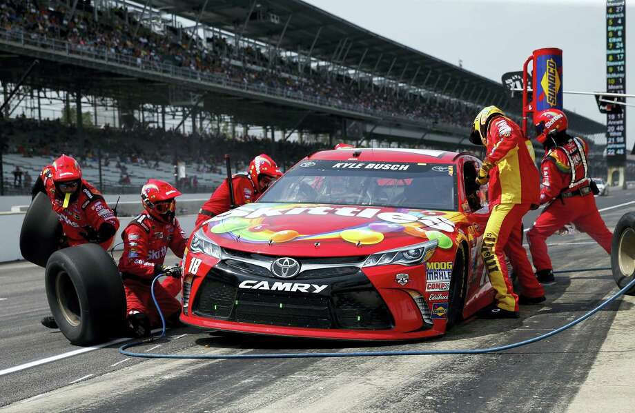 Kyle Busch makes a pit stop during the Brickyard 400 at Indianapolis Motor Speedway on Sunday. Photo: Rob Baker — The Associated Press   / Copyright 2016 The Associated Press. All rights reserved. This material may not be published, broadcast, rewritten or redistribu
