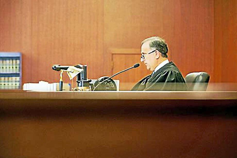 Judge Thomas Moukawsher reads his decision. Photo: Stephanie Aaronson/Dow Jones