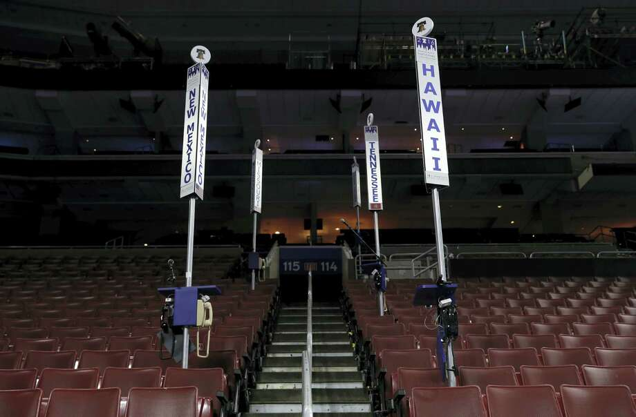 State delegation signs are seen on the convention floor as preparations continue for the 2016 Democratic National Convention in Philadelphia on July 23, 2016. Photo: AP Photo/Carolyn Kaster   / Copyright 2016 The Associated Press. All rights reserved. This material may not be published, broadcast, rewritten or redistribu