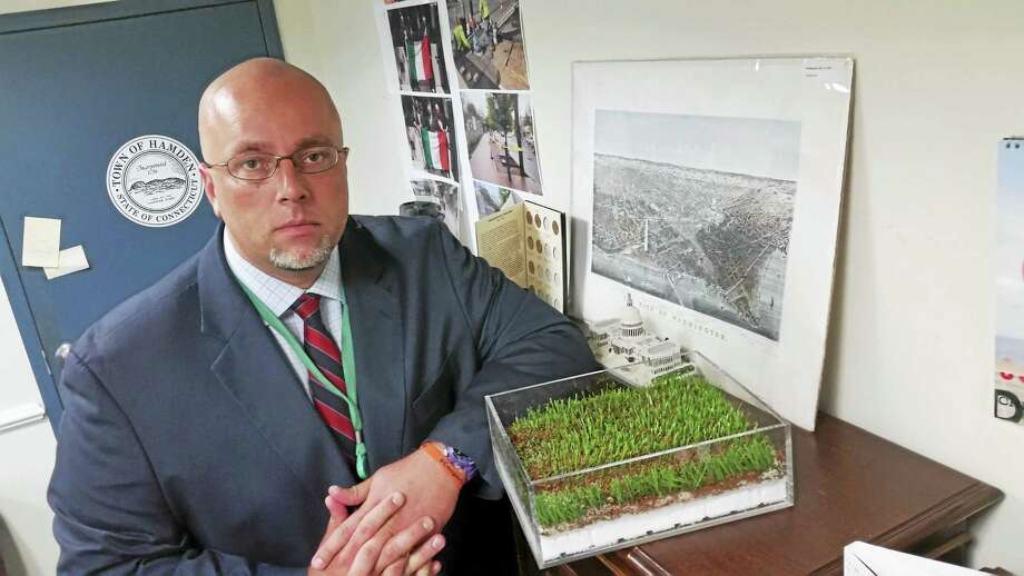 Hamden Mayor Curt Leng with a sample of the new cork and coconut turf to be used for the baseball field. Photo: Kate Ramunni — New Haven Register