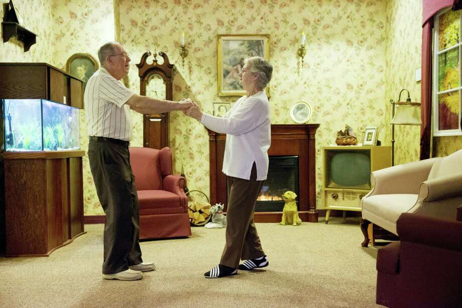 Decima Assise, who has Alzheimer's disease, and Harry Lomping dance to old music in a replica mid 1900s living room on Nov. 6, 2015 at The Easton Home in Easton, Pa. Photo: AP Photo/Matt Rourke   / AP