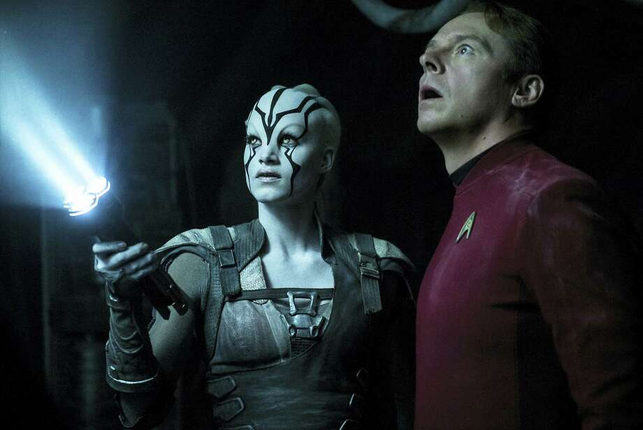 "In this image provided by Paramount Pictures, Sofia Boutella, left, plays Jaylah and Simon Pegg plays Scotty in Star Trek Beyond. ""Star Trek Beyond"" has landed atop the weekend box office. According to studio estimates Sunday, July 24, 2016, the latest outing for the Starship Enterprise soared to $59.6 million in North American ticket sales, knocking ""The Secret Life of Pets"" from the No. 1 spot. Photo: Kimberley French/Paramount Pictures Via AP   / Paramount Pictures"