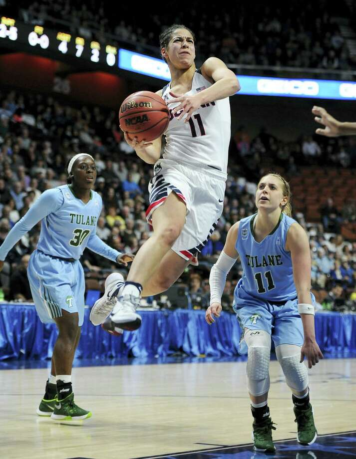 Connecticut's Kia Nurse, center, drives to the basket as Tulane's Tierra Jones, left, and Tulane's Leslie Vorpahl, right, defend, during the first half of an NCAA college basketball game in the American Athletic Conference tournament semifinals at Mohegan Sun Arena, Sunday, March 6, 2016, in Uncasville, Conn. (AP Photo/Jessica Hill) Photo: AP / FR125654 AP