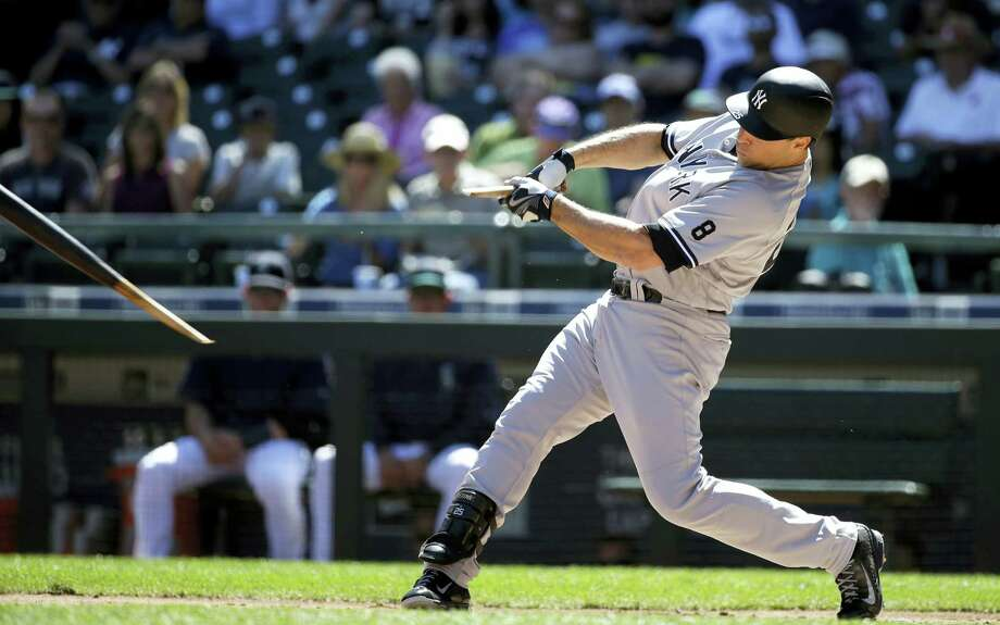 New York first baseman Mark Teixeira breaks his bat as he grounds out in the first inning of Wednesday's 5-0 win for the Yankees over the Seattle Mariners. Photo: ELAINE THOMPSON - THE ASSOCIATED PRESS   / Copyright 2016 The Associated Press. All rights reserved. This material may not be published, broadcast, rewritten or redistribu